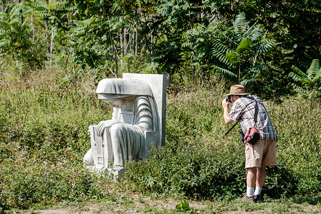 Someone takes a photo of the Duane Linklater installation during Ravine Days.