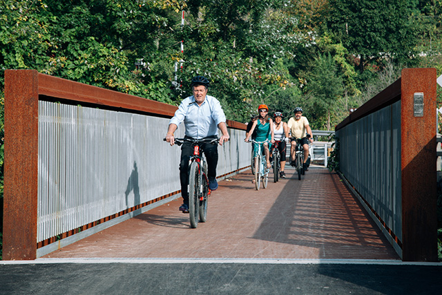 Toronto Mayor John Tory cycles across the Pottery Road Bridge.